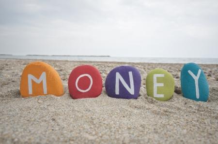 Money, conceptual colourful stones composition