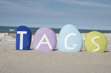 stratgy: concept of tags on colourful stones Stock Photo