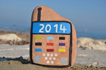 Bonne Ann�e 2014 sur un mobile de pierre Banque d'images