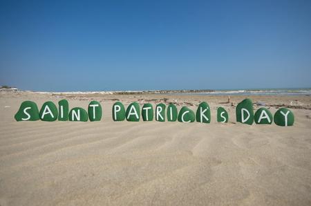 saint patrick��s day: Saint Patrick s Day on stones over the sand Stock Photo
