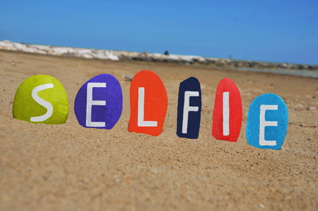 Selfie concept on colourful stones