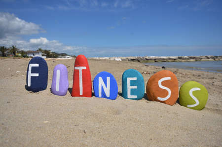 Fitness, conceptual composition stones on the sand Stock Photo