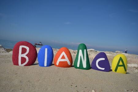 Bianca, female name on colored stones Stock Photo