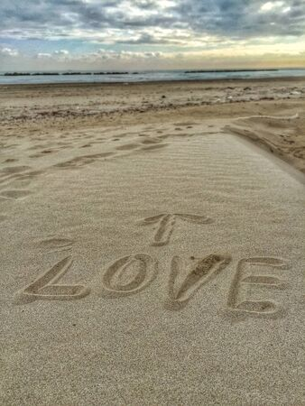 Love message on the sand