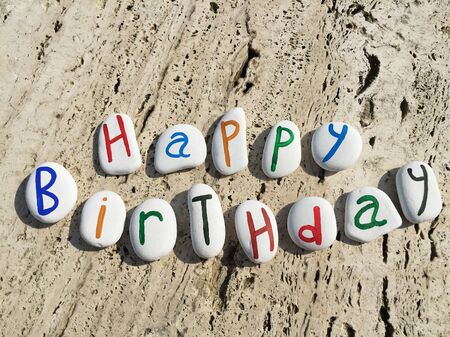 Happy birthday greetings on colored stone letters