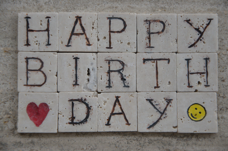 Happy Birthday on carved marble pieces