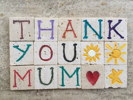 Thank you mum, love message on carved letters