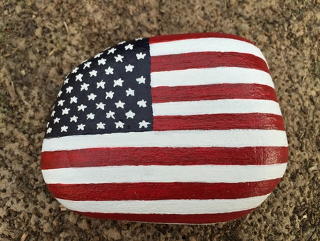 artistic: USA flag painted on a stone Stock Photo
