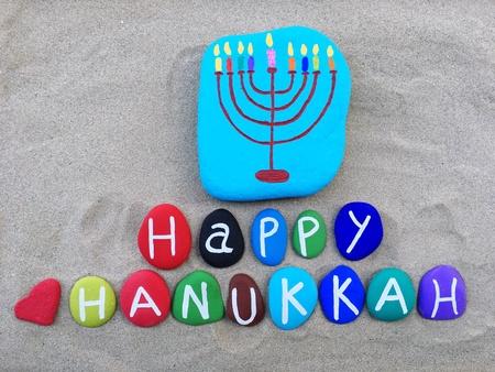 Happy Hanukkah on colored stones Stock Photo