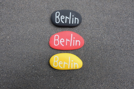 Berlin text on three stones with german flag colors