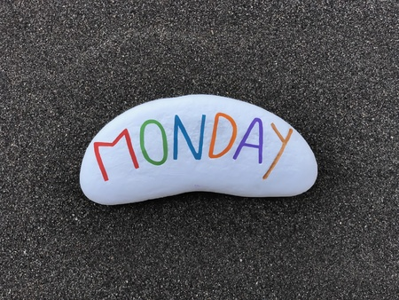 Monday, first day of the week, carved and colored text