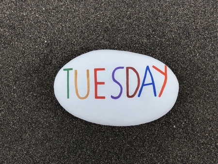 Tuesday, second day of the week, text carved and colored on a stone