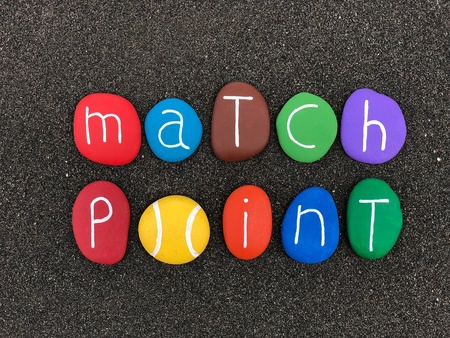 Match point text composed of carved and painted stones Stock Photo