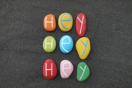 Hey, hey, hey, trendy text with colored sea stones over black 写真素材
