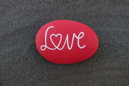 Love text on a red colored stone