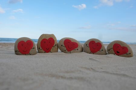 Red heart stones on the beach