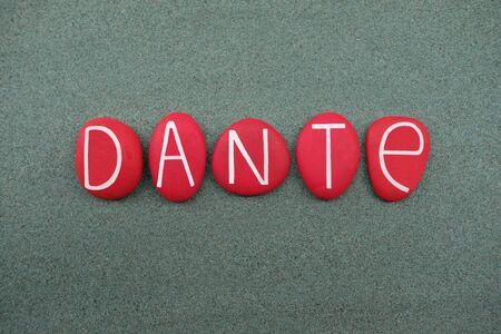 Dante, male given name composed with red colored stone letters over green sand