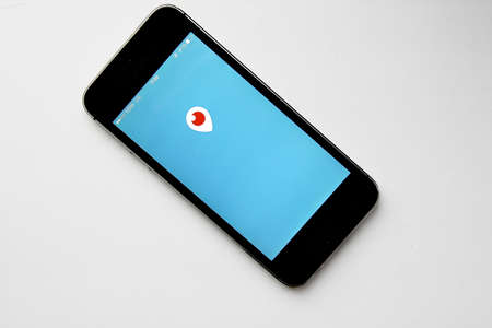 htc: MOSCOW, RUSSIA - FEBRUARY 19, 2016: Periscope mobile app logo in screen on a Apple iPhone 5s. Periscope is made by Twitter - online broadcast from any point where you have internet connection. Live video.