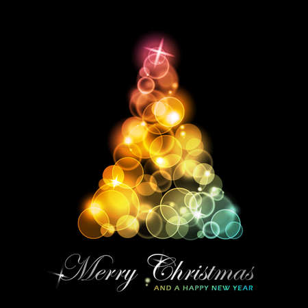 lights background: Light dots of in shades of red, yellow, golden to green blue forming a sparkling Christmas tree.