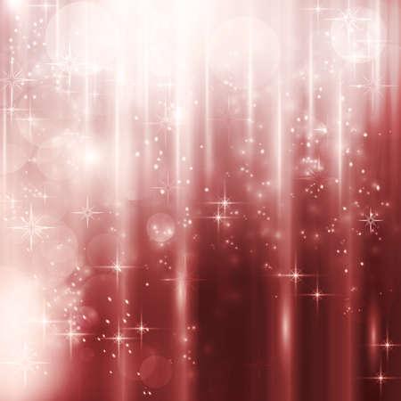 effets lumiere: R�sum� de No�l, fond en hiver avec des effets de lumi�re, des �toiles et des points de lumi�re floues dans les tons de rouge.