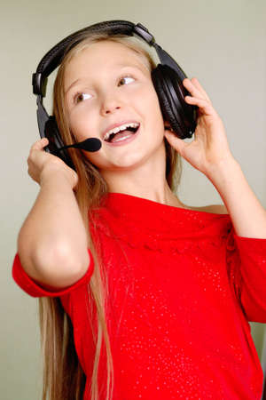portrat laughing girl is in headphones photo