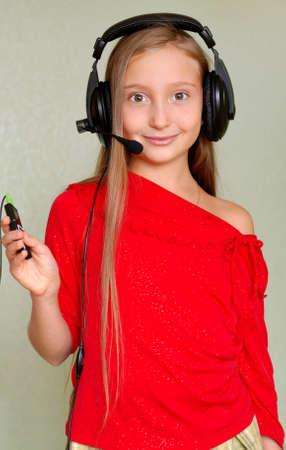 girl is in headphones photo