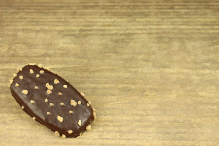 icing: Biscuit with chocolate icing on wooden background