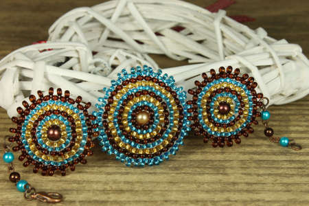 Bracelet in detail on wooden background, blue and brown beads