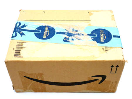 Italy – August 10, 2019: Used AMAZON Shipping Package Parcel Cardboard Box. Amazon is an American Multinational Technology Company of e-commerce Stockfoto - 150130844