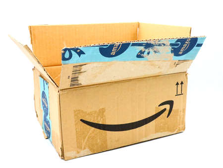 Italy – August 10, 2019: Used AMAZON Shipping Package Parcel Cardboard Box. Amazon is an American Multinational Technology Company of e-commerce Stockfoto - 150130846