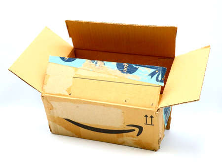 Italy – August 10, 2019: Used AMAZON Shipping Package Parcel Cardboard Box. Amazon is an American Multinational Technology Company of e-commerce Stockfoto - 150130850