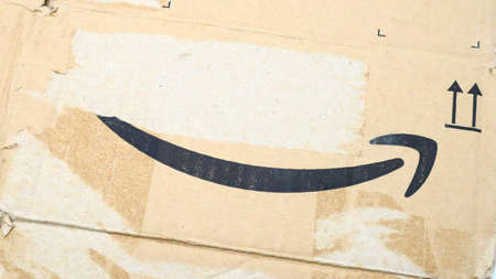 Italy – August 10, 2019: Used AMAZON Shipping Package Parcel Cardboard Box. Amazon is an American Multinational Technology Company of e-commerce Stockfoto - 150130858