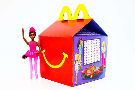 Los Angeles, California – December 2, 2019: McDonald's Happy Meal cardboard box with Mattel Barbie doll. McDonald's is a fast food restaurant chain.