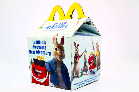 Los Angeles, California – December 2, 2019: McDonald's Happy Meal cardboard box with PETER RABBIT 2018 Animated Film. McDonald's is a fast food restaurant chain