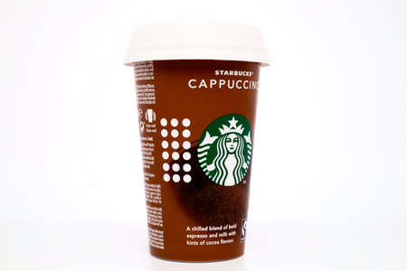 Italy – January 1, 2020: Starbucks Cappuccino cup with straw. Starbucks is an American coffee company and coffee house chain
