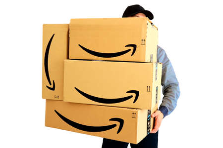 Los Angeles, USA – February 24, 2021: AMAZON Shipping Cardboard Boxes. Amazon is an American Multinational Technology Company of e-commerce