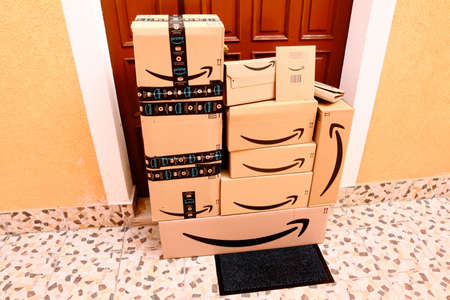 USA – February 26, 2021: AMAZON Cardboard Boxes delivered at home to the front door