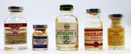 New York, USA – April 18, 2021: Vintage 1950s Vials of PENICILLIN G Produced by CSC Pharmaceuticals New York, PFIZER New York, SPECIA Paris, LEO Rome and SQUIBB Rome