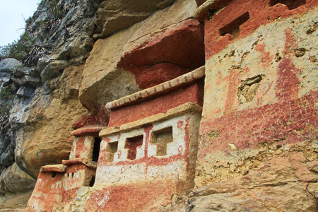 historica: Pre inca mausoleum Revash in the mountains of northern Peru. Famous for the built in the wall and for the colorfull red and brown paintings.