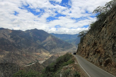 humid south: Nice mountain road with nice panorama trough northern Peru near Chachapoyas. You see a van on the road, vanlife.