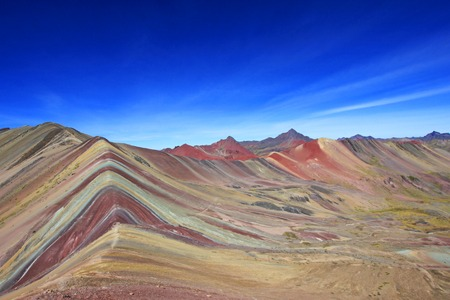 high view: The beautiful colored Rainbow Mountain panorama near Cusco Peru. Nice view into the hole valley. Located about 20km south of Ausangate mountain.