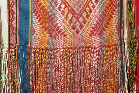 Details shot of wool fabric with colorful pattern, inca indian pattern.