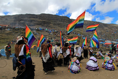 Parade at Quylluriti inca festival in the peruvian andes near ausangate mountain, one of the oldest, nicest and most traditional religious ceremonies in the world