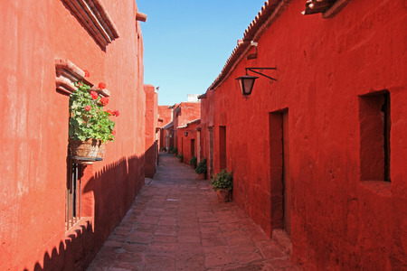 predominantly: The famous monastery of Saint Catherine, Santa Catalina, in Arequipa, Peru. It belongs to the Dominican Second Order. Its built predominantly in the Mudejar style in 1579. Stock Photo