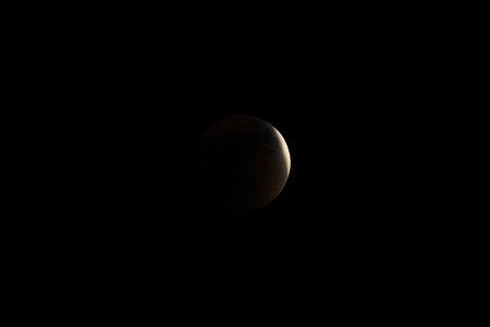 totality: Partial before total lunar eclipse 2015, also known as blood moon, photographed sep 27th, 8-11 pm, in the mountains of Colombia at 3560 mabsl, national park Cocuy. Stock Photo