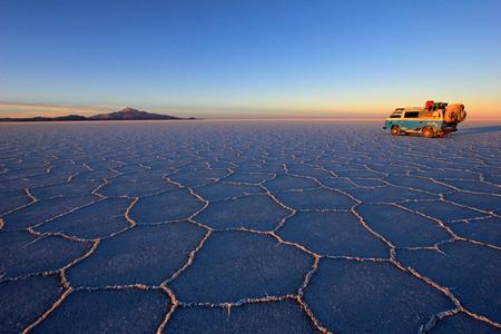 salt flat: Van on Salar de Uyuni, salt lake, is largest salt flat in the world, altiplano, Bolivia, South America Stock Photo