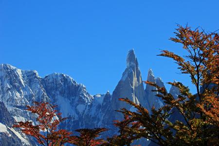 Cerro Torre mountain in autumn colors. Los Glaciares National park, Patagonia, Argentina, background mountain in focus