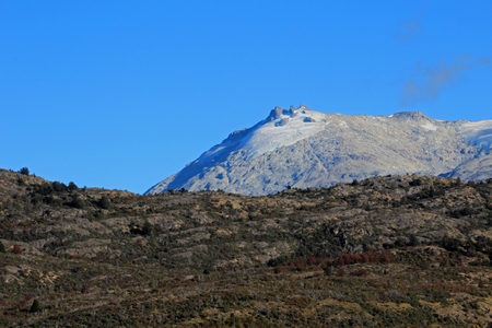 and hiking path: Mountain shaped by the erosion of a glacier, along Carretera Austral, Patagonia, Chile Stock Photo