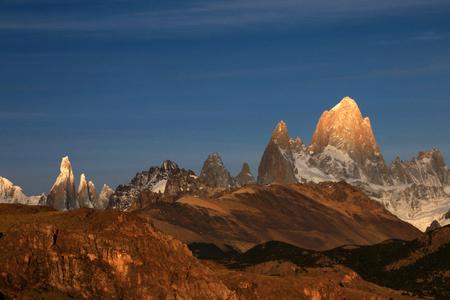 Fitz Roy and Cerro Torre mountainline at sunrise, Los Glaciares National Park, El Challten, Patagonia, Argentina Stock Photo