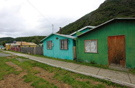water alphabet: Houses in Villa OHiggins, Carretera Austral, Patagonia, Chile Stock Photo
